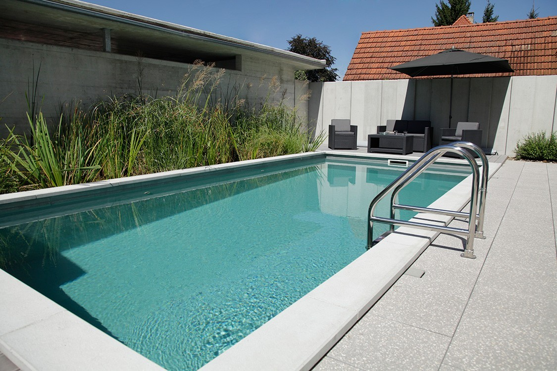 biotop bio pool with solar heating on the garage roof. Black Bedroom Furniture Sets. Home Design Ideas