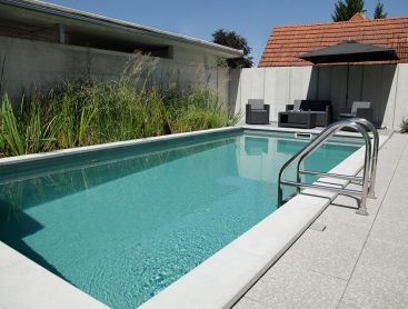 Bio Pool In Switzerland With Solar Heating On The Carport