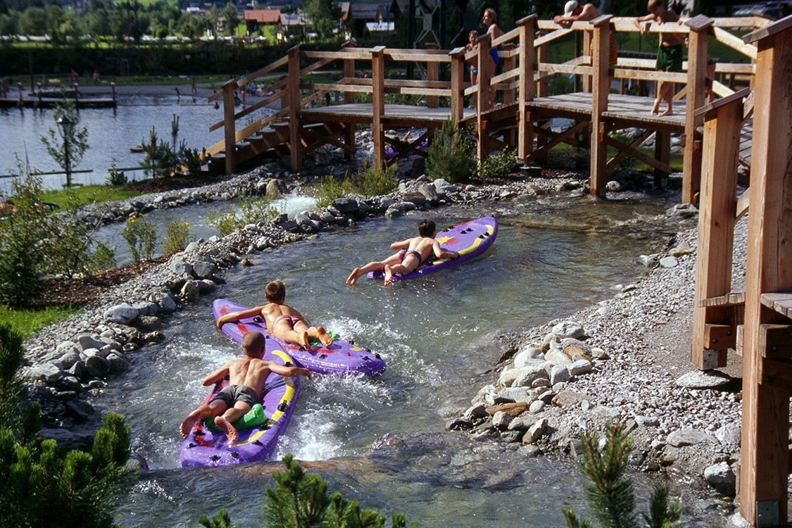 natural pool in Austria with raft ride