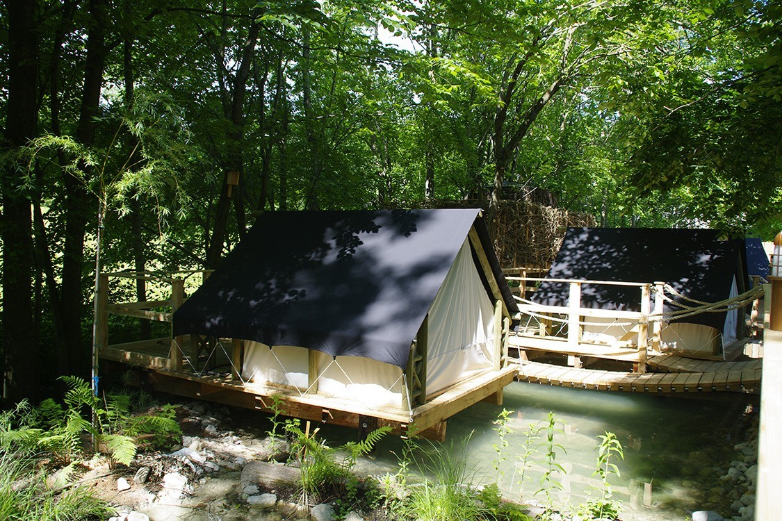 natural pool in slovenia with camping in tree houses