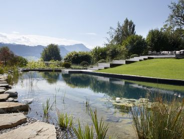 Natural Pool in Switzerland with a Harmonious Garden Concept