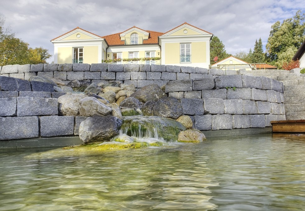 natural pool with natural stone wall and cascade